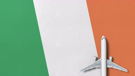 vliegticket : Commercial plane on the flag of Ireland. Tourism related conceptual 3D animation