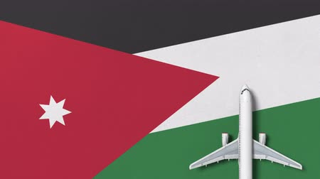 Иордания : Top-down view of the airplane on the flag of Jordan. Tourism related conceptual 3D animation