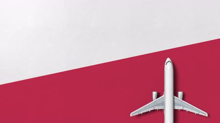 flat lay : Commercial airplane on the flag of Poland. Travel related conceptual 3D animation