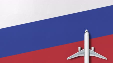 lay : Top-down view of the airplane on the flag of Russia. Tourism related conceptual 3D animation