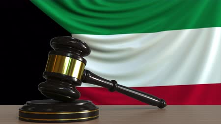 licit : Judges gavel and block against the flag of Kuwait. Kuwaiti court conceptual animation