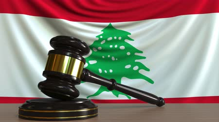 kural : Judges gavel and block against the flag of Lebanon. Lebanese court conceptual animation