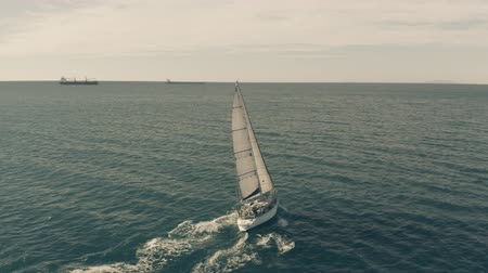 schipper : CIVITAVECCHIA, ITALY - JANUARY 1, 2019. Aerial view of a sailboat sailing at sea