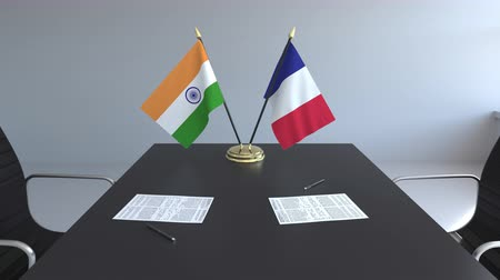 ondertekening : Flags of India and France and papers on the table. Negotiations and signing an international agreement. Conceptual 3D animation Stockvideo