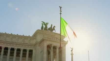 emanuele : Waving flag of Italy and historic Vittorio Emanuele II Monument on Piazza Venezia square