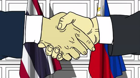 diplomatie : Businessmen or politicians shake hands against flags of Thailand and Philippines. Official meeting or cooperation related cartoon animation