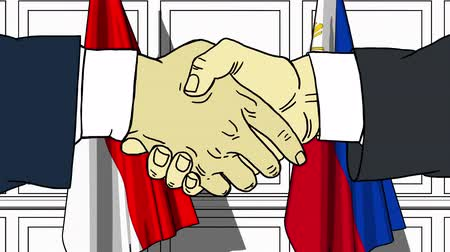 treaty : Businessmen or politicians shake hands against flags of Indonesia and Philippines. Official meeting or cooperation related cartoon animation