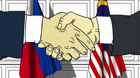 politicians : Businessmen or politicians shake hands against flags of Philippines and Malaysia. Official meeting or cooperation related cartoon animation Stock Footage