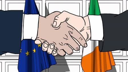 politicians : Businessmen or politicians shake hands against flags of the EU and Ireland. Official meeting or cooperation related cartoon animation