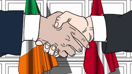 politicians : Businessmen or politicians shake hands against flags of Ireland and Denmark. Official meeting or cooperation related cartoon animation