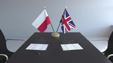 assinatura : Flags of Poland and the United Kingdom and papers on the table. Negotiations and signing an international agreement. Conceptual 3D animation