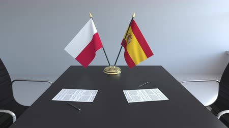 assinatura : Flags of Poland and Spain and papers on the table. Negotiations and signing an international agreement. Conceptual 3D animation