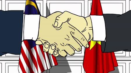 desenhado : Businessmen or politicians shake hands against flags of Malaysia and Vietnam. Official meeting or cooperation related cartoon animation
