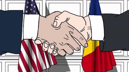 Румыния : Businessmen or politicians shake hands against flags of the USA and Romania. Official meeting or cooperation related cartoon animation Стоковые видеозаписи
