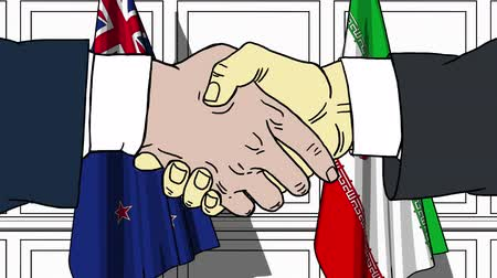 nowa zelandia : Businessmen or politicians shake hands against flags of New Zealand and Iran. Official meeting or cooperation related cartoon animation Wideo