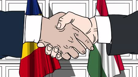 politicians : Businessmen or politicians shake hands against flags of Romania and Hungary. Official meeting or cooperation related cartoon animation Stock Footage