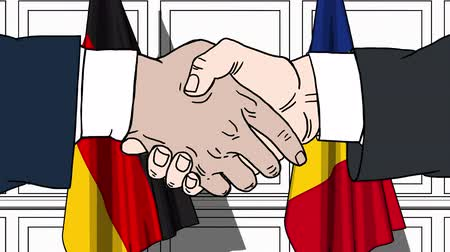 politicians : Businessmen or politicians shake hands against flags of Germany and Romania. Official meeting or cooperation related cartoon animation Stock Footage