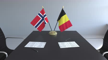 bélgica : Flags of Norway and Belgium and papers on the table. Negotiations and signing an international agreement. Conceptual 3D animation