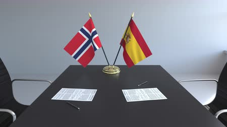assinatura : Flags of Norway and Spain and papers on the table. Negotiations and signing an international agreement. Conceptual 3D animation Vídeos
