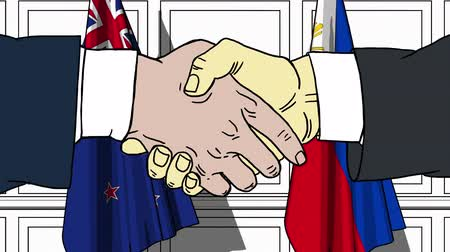nowa zelandia : Businessmen or politicians shake hands against flags of New Zealand and Philippines. Official meeting or cooperation related cartoon animation Wideo