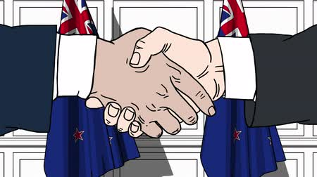 nowa zelandia : Businessmen or politicians shake hands against flags of New Zealand. Official meeting or cooperation related cartoon animation Wideo