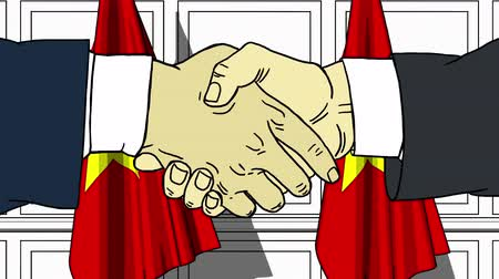 politicians : Businessmen or politicians shake hands against flags of Vietnam. Official meeting or cooperation related cartoon animation