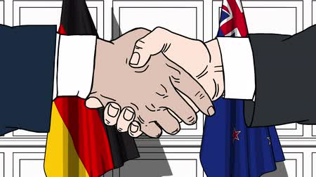 nowa zelandia : Businessmen or politicians shake hands against flags of Germany and New Zealand. Official meeting or cooperation related cartoon animation