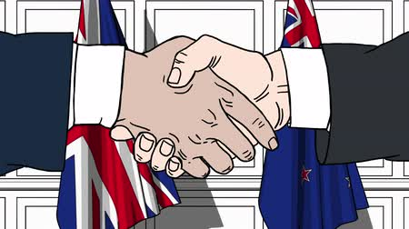 nowa zelandia : Businessmen or politicians shake hands against flags of Great Britain and New Zealand. Official meeting or cooperation related cartoon animation