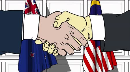 nowa zelandia : Businessmen or politicians shake hands against flags of New Zealand and Malaysia. Official meeting or cooperation related cartoon animation Wideo