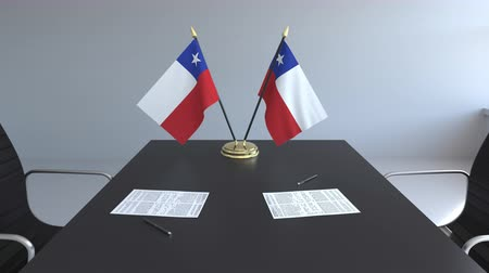 chileno : Flags of Chile and papers on the table. Negotiations and signing an agreement. Conceptual 3D animation