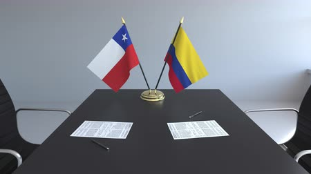 colômbia : Flags of Chile and Colombia and papers on the table. Negotiations and signing an international agreement. Conceptual 3D animation