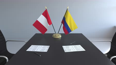 colômbia : Flags of Peru and Colombia and papers on the table. Negotiations and signing an international agreement. Conceptual 3D animation
