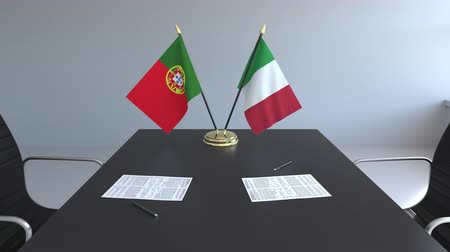 assinatura : Flags of Portugal and Italy and papers on the table. Negotiations and signing an international agreement. Conceptual 3D animation