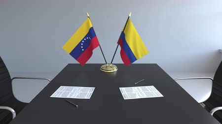 colômbia : Flags of Venezuela and Colombia and papers on the table. Negotiations and signing an international agreement. Conceptual 3D animation