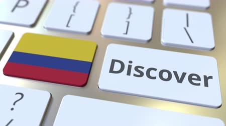 keşfetmek : DISCOVER text and flag of Colombia on the buttons on the computer keyboard. Conceptual 3D animation Stok Video