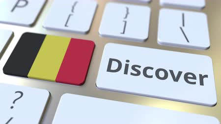 descobrir : DISCOVER text and flag of Belgium on the buttons on the computer keyboard. Conceptual 3D animation Vídeos