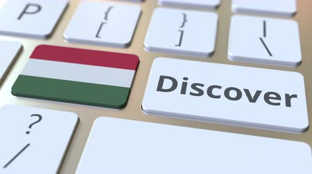 descobrir : DISCOVER text and flag of Hungary on the buttons on the computer keyboard. Conceptual 3D animation