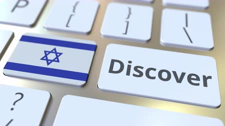 descobrir : DISCOVER text and flag of Israel on the buttons on the computer keyboard. Conceptual 3D animation Vídeos