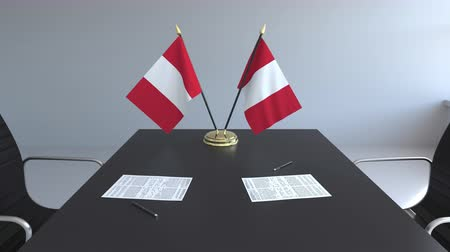 перуанский : Flags of Peru and papers on the table. Negotiations and signing an agreement. Conceptual 3D animation Стоковые видеозаписи