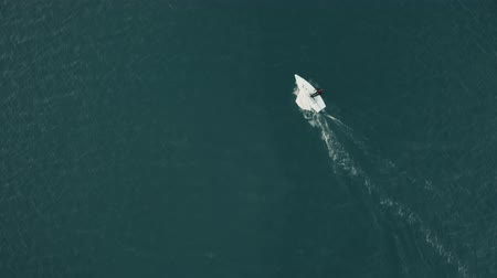 denizciler : TERRACINA, ITALY - DECEMBER 30, 2018. Aerial top down view of a small sailboat sailing at sea