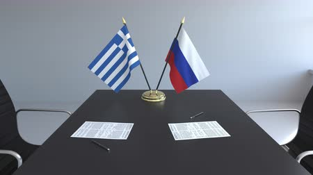 greek flag : Flags of Greece and Russia and papers on the table. Negotiations and signing an international agreement. Conceptual 3D animation