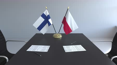 assinatura : Flags of Finland and Poland and papers on the table. Negotiations and signing an international agreement. Conceptual 3D animation Vídeos