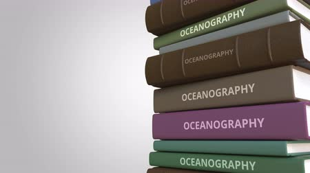 oceány : Stack of books on OCEANOGRAPHY, loopable 3D animation