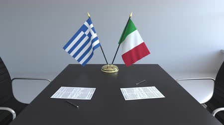 assinatura : Flags of Greece and Italy and papers on the table. Negotiations and signing an international agreement. Conceptual 3D animation Vídeos