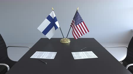 assinatura : Flags of Finland and the United States and papers on the table. Negotiations and signing an international agreement. Conceptual 3D animation