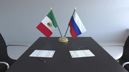 assinatura : Flags of Mexico and Russia and papers on the table. Negotiations and signing an international agreement. Conceptual 3D animation