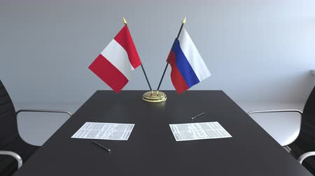 negotiations : Flags of Peru and Russia and papers on the table. Negotiations and signing an international agreement. Conceptual 3D animation Stock Footage