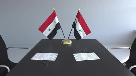 syrian : Flags of Syria and papers on the table. Negotiations and signing an agreement. Conceptual 3D animation