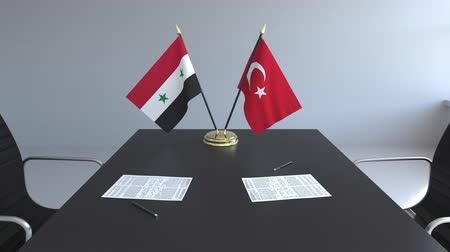 syrian : Flags of Syria and Turkey and papers on the table. Negotiations and signing an international agreement. Conceptual 3D animation Stock Footage