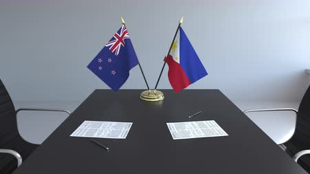 nowa zelandia : Flags of New Zealand and Philippines and papers on the table. Negotiations and signing an international agreement. Conceptual 3D animation Wideo